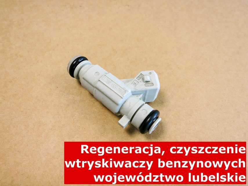 Wtryskiwacz jednopunktowy z województwa lubelskiego na stole w laboratorium, zrewitalizowany przy pomocy specjalnego sprzętu