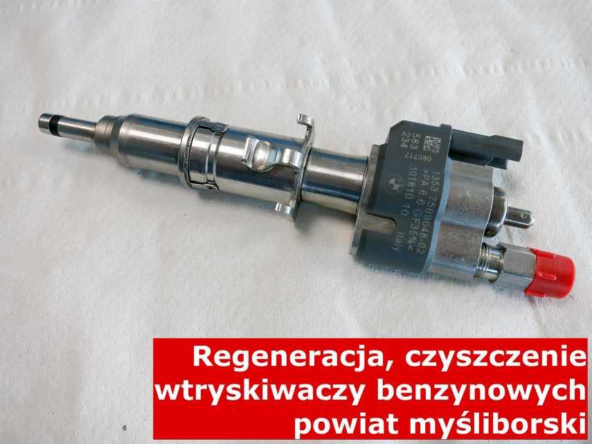 Wtryskiwacz benzyny na stole w laboratorium, zregenerowany na odpowiedniej maszynie • powiat myśliborski